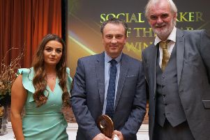 NI Social Worker of the Year, Extern's Mal Byrne (centre), with awards hosts Tim McGarry and Lucy Lakin.