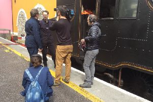 A French TV crew carries out an interview with Whitehead-based volunteer Chris Ragg during a servicing stop at Killarney on the 2018 Two-Day tour.