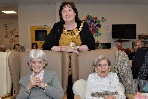 The Mayor of Mid and East Antrim, Cllr Maureen Morrow, paid a visit to Knockagh Rise Nursing Home for the 100th birthday celebrations of May McCracken (left) and Ivy Scott. INCT 04-002-PSB