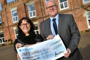 Ragdale Hall Spa directors Hugh Wilson and Allison Garner with a cheque for ?10,000 to be allocated once again to community groups, charities and clubs through our Make It Happen funding scheme EMN-201102-162035001
