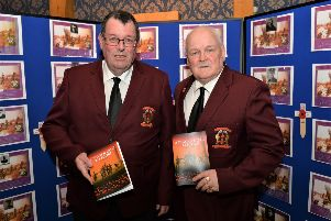Paul Duffin (left) secretary of the Larne & District Great War Society and Alan Rice, chairman, at the launch of 'A Bigger Goal To Score' about footballers from the Larne area who served in the First World War. INLT 08-003-PSB