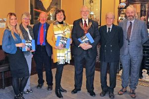 Zoe Latimer, Marketing and Events manager; Dr. Joan Smyth, president; Robin Morton, volunteer;  MEA Mayor, Councillor Maureen Morrow; John McKegney, chairman,  Lord O'Neil and Mark Kennedy, museum curator.