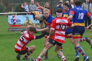 Leamington centre Toby Bruce takes on the Earlsdon defence. Picture: Gina Ruyssevelt