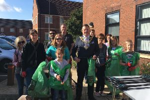 Warwick Mayor Richard Eddy joined residents to help clen up Chase Meadows.