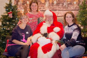 Left to right: Nicki Scott, Bailey Lamburn and Lucy Field with Father Christmas. Photo by Offspring Photography