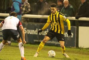 Jordan Murphy takes on his marker in the 1-0 home defeat by Stockport County in midweek. Picture: Tim Nunan