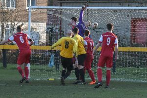 Rocester keeper Carl Allen is unable to prevent Scott Turner opening the scoring for Racing Club. Pictures: Louise Smith
