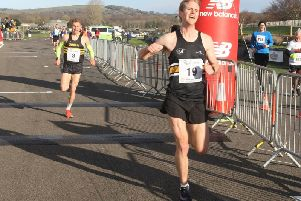 Paul Navesey - seen here finishing a second behind winner Will Mycroft - was the top Sussex runner in the Chi Priory 10k / Picture by Derek Martin