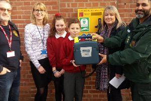 Left to right: Roy Shearing (Kenilworth Rotary Club), Mrs Louise Mohacsi (Headteacher at St Nicholas C of E Primary School), pupils Matilda and Tom, Jane Hunt (School Office) and Bobby Qayum. Photo submitted.