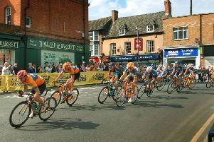 Riders sweep through Melton as they begin the finishing circuit EMN-190214-151334002