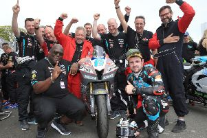 Michael Dunlop celebrates his Supersport TT victory last year with his MD Racing team.