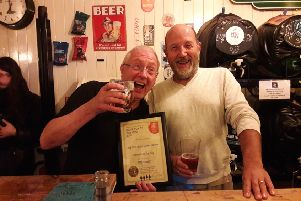 Steve Pardoe, branch co-ordinator for Brighton and South Downs CAMRA, presents the award to Old Star Ale and Cider House landlord Richard Hasler, left