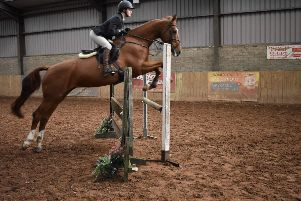 Holly Wray and Springhill Summer on their way to winning the 90cm class