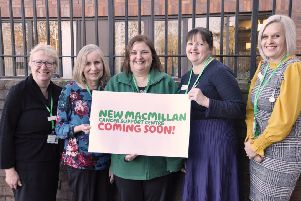 The Macmillan cancer information and support team standing outside the site where the new support centre will be located. Images supplied.
