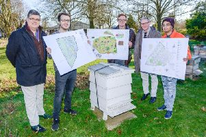 Pictured at the apiary, from left to right, are Mike Roberts, Ian Burns, Jack Llewellyn, George Brown (BBKA) and Anish Mistry.