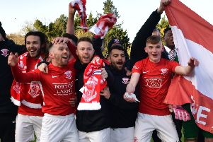 Larne celebrate after winning promotion after their win over Ballinamallard