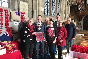 The Warwick Poppies team presenting Warwick Mayor Richard Eddy with a framed display of knitted poppies as a mark of their gratitude for his personal support during his Mayoral year. Photo submitted.