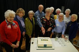 Former  National Chair Pam Jones  and West Wolds Chairman Steve McCarthy cut the cake watched by some of the founding and long-serving members EMN-190317-155244001
