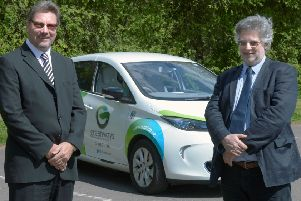 From left, Nik Chambers, Greenway's operations director, and Paul Howell, with one of the firm's electric pool cars.
