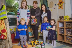 Headteacher Cathy Bignold with volunteers Louise and Dianne and nursery children. Photo by Michelle Lutley. Photo submitted.
