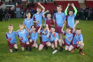 The St. John's Primary School team celebrate after lifting the Club Derry Cup at the doire GAA mBunscol finals at Owenbeg on Friday.