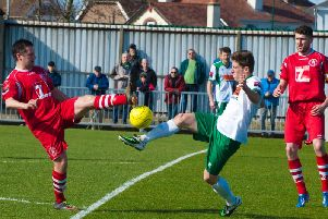 Stuart Green vies for possession in his previous Rocks spell, in a 2015 clash with Leiston / Picture by Tommy McMillan