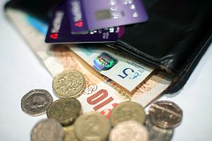 File photo dated 29/01/17 of money and bank cards in a wallet, as the UK tax burden is set to rise to its highest level for 30 years under Chancellor Philip Hammond's plans, despite continuing cuts in public services, according to an influential economic think tank. PRESS ASSOCIATION Photo. Issue date: Tuesday February 7, 2017. And the austerity regime of tax rises and spending cuts is set to continue well into the 2020s, thanks to Mr Hammond's decision in the wake of the Brexit vote to scrap George Osborne's target of balancing the nation's books by 2019, said the Institute for Fiscal Studies. See PA story POLITICS IFS. Photo credit should read: Yui Mok/PA Wire
