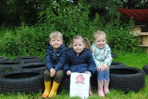 Nursery school children with the award for Banana Moon Nursery. Photo supplied.