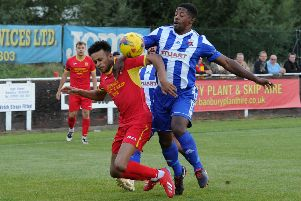 Banbury United's Amer Awadh takes a tumble against Nuneaton on Tuesday. Photo: Jake McNulty