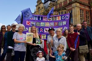 Members of the Extinction Rebellion Warwick District group outside Leamington Town Hall.