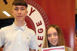 GCSE Top Achievers, Jonathan Edge and Jodie McCord with 12 GCSEs each.