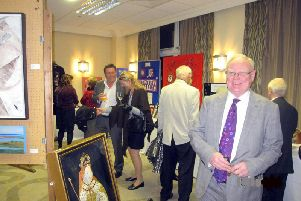 Visitors at a previous Kenilworth Rotary Club Art Exhibition and Peter Roberts, a member of the rotary club