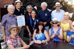 Members of the Warwick Lions Club with local knitters. Photo submitted.