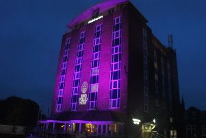 Purple light with END POLIO NOW symbol expected to light up the Holiday Inn building on October 24