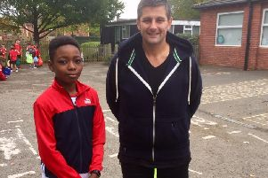 Ethan and Mr Sanderson after having just finished the Cross Country running club after school