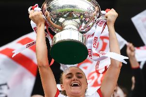 Tyrone captain Neamh Woods lifts the Mary Quinn Memorial cup following the TG4 All-Ireland Ladies Football Intermediate Championship Final match between Meath and Tyrone at Croke Park, Dublin