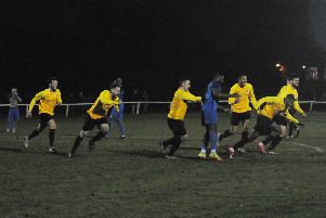 Racing Club Warwick players race after Trea Bertie after his injury-time winner. Pictures: Morris Troughton
