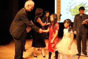 Philomena (in red dress) receives her award from the Mayor of Milton Keynes