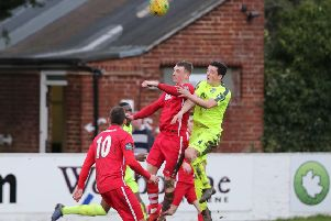 Hastings United defender Tom Climpson goes up for a header during last weekend's 1-1 draw away to Whitstable Town. Picture courtesy Scott White