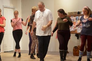 The cast of Stepping Out in rehearsals for their production