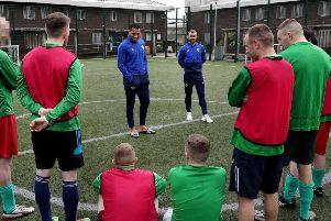 Josh Magennis and Niall McGinn visit the 'Stay Onside' programme at HMP Maghaberry