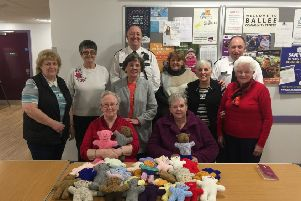 CI Stephen Humphries and Sergeant Stephen Rainey pictured with members of the Ballee Community Centre knitting club.