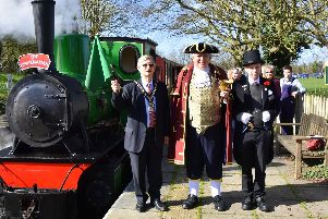 Town mayor Clive Palmer flags off the first train of the season