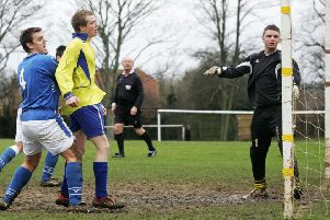 AFC Oldhill (yellow) v Sportsmans Arms (blue) in a semi-final, at Pages Park, Leighton Buzzard.