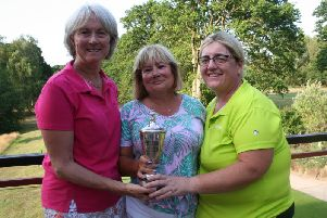 Ladies champion Judy Ammon (left) with Captain Carmen White-Lawes and runner-up Jenny Stafford.