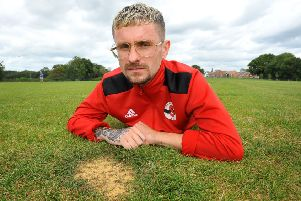 Ryan Taylor with just one of the divot holes created by golfers damaging Southwater's football club's pitch. Pic Steve Robards SR1922105 SUS-190309-135454001