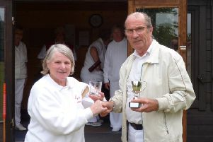 Pauline Donner, Chair of Woodhall Spa Croquet Club, presents Barrie Darling with the winners cup and an engraved glass.
