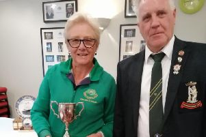 Maureen Edwards won the RBA ladies' singles and was presented with the trophy by RBA president elect Terry Fuller
