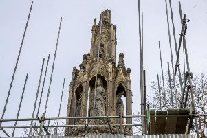 Scaffolding on the Hardingstone Eleanor Cross as repairs began in April