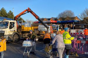 Residents collecting water at Tesco during the weekend of the water crisis. Credit: Branko Bjelobaba